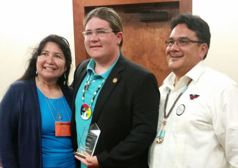 Dahkota Brown, center, with Mari Levi, left, president of the American Indian/Alaskan Native Education caucus for the California Teachers Association, and Marty Meeden, board member of the CTA.