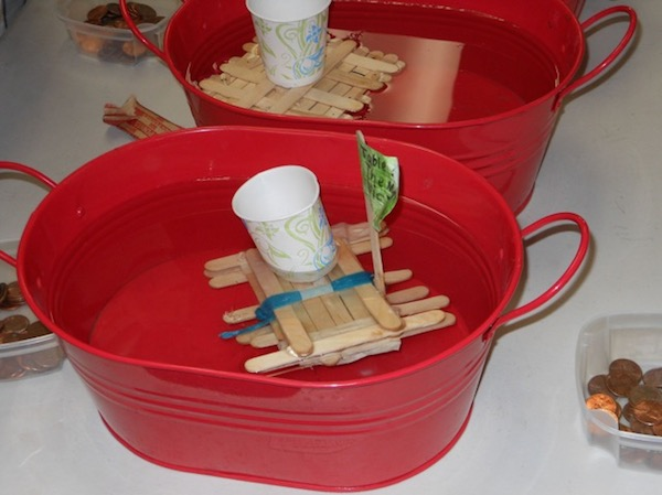 "Students' rafts – part of a project based on the book ""Hatchet"" by Gary Paulsen – are put to the test in tubs of water."