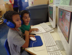 Diego Sandoval, right, and Giovanny Andres play an English and phonics game on the computer during a Head Start class in Norwalk on Sept. 14, 2015