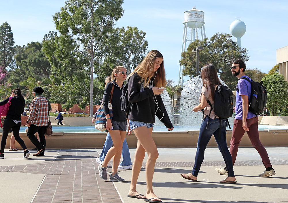 Cal State Long Beach Students Walk Along The Campus University Has Ced Enrollment Despite